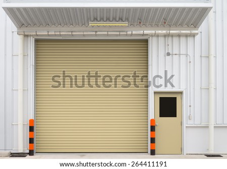 Shutter door or roller door and concrete floor outside factory building use for industrial background. Shutter door use for industrial building such as factory garage and warehouse.  - stock photo