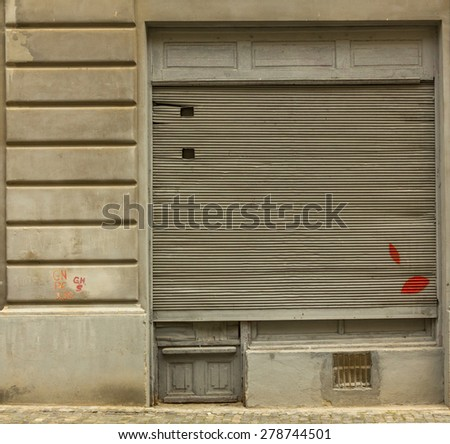 Shutter of communist old store  - stock photo
