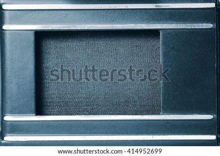 Shutter old film camera. Close up view. Macro. Vintage photo toning. - stock photo
