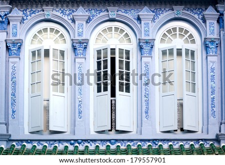 Shutters of a shophouse, in Singapore. - stock photo