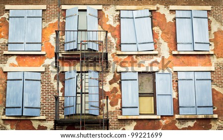 Shutters on the exterior wall of an old city building - stock photo