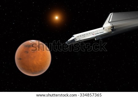 Shuttle on the way to mars - Elements of this image furnished by NASA - stock photo