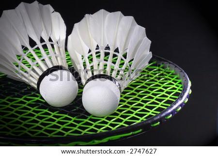 Shuttlecock and badminton - stock photo
