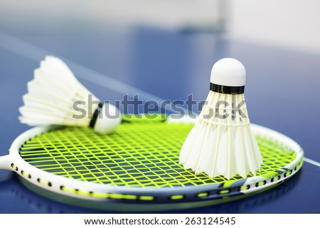 Shuttlecock on badminton racket - stock photo