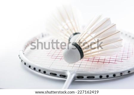 Shuttlecock on badminton racket closeup - stock photo