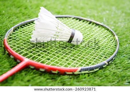 Shuttlecocks and badminton racket - stock photo