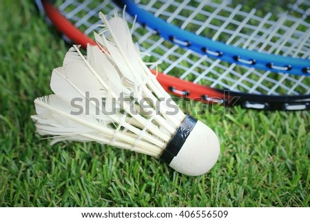 Shuttlecocks with badminton racket