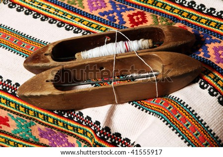 Shuttles and Ukrainian decorative pattern - stock photo