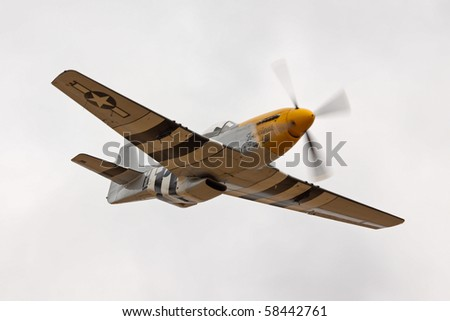 SHUTTLEWORTH, BEDFORDSHIRE - AUGUST 1: 1944 P-51D Mustang 413704 in flight at the Air Display on AUGUST 1, 2010 at Shuttleworth, Old Warden Park, Bedfordshire, UK.