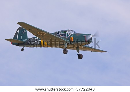SHUTTLEWORTH, BEDFORDSHIRE - JULY 5: Bucker Bu-181B-1 Bestmann in flight at the Military Pageant Air Display on July 5, 2009 in Shuttleworth, Old Warden Park, Bedfordshire, UK.