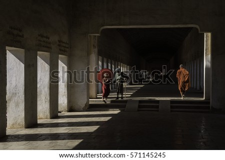 Shwezigon pagoda, Bagan, Mandalay, Myanmar - January 21, 2017 : Passing by in the hallway to Shwezigon pagoda