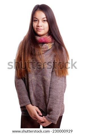 shy asian teenage girl wearing scarf and sweather - stock photo
