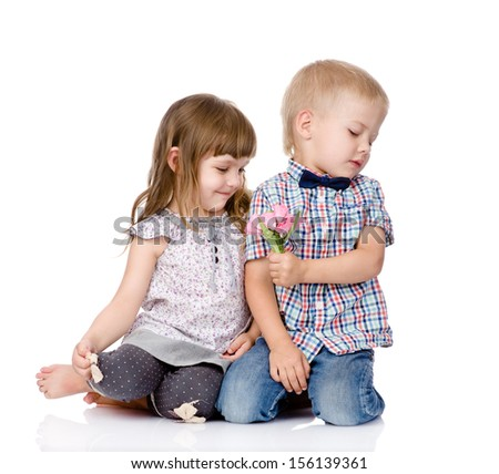 shy boy gives to the girl a flower. isolated on white background