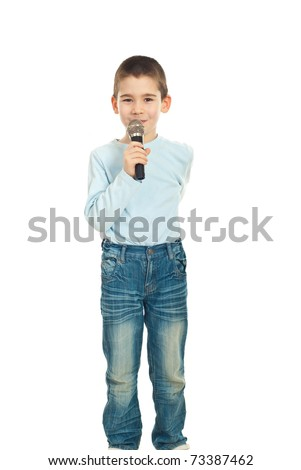Shy boy singing to microphone isolated on white background - stock photo