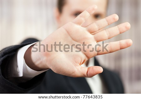 Shy business men hand gesture hide face stop sign - stock photo