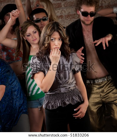 Shy girl at a 1970s Disco Music Party - stock photo