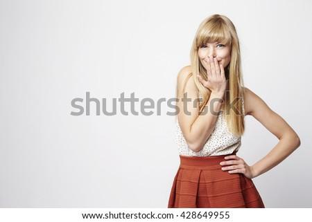 Shy girl posing in studio, portrait - stock photo