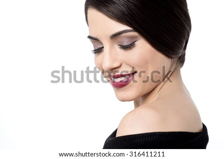 Shy lady wearing a bright makeup - stock photo