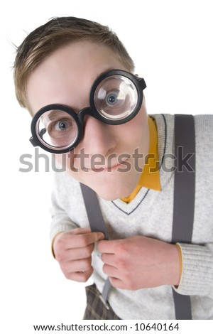 Shy nerd in funny glasses. Smiling and looking at camera. Holding his strap. High angle view, white background - stock photo