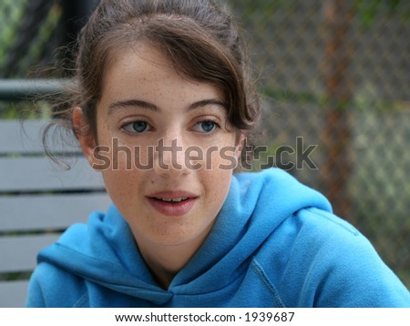 Shy teen girl with freckles - stock photo
