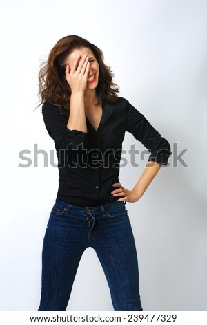 Shy woman hiding face laughing timid - stock photo