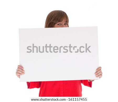Shy woman holding a big blank card, isolated on white
