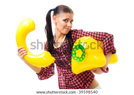 Shy woman want to make a call by big funny yellow phone, isolated on white