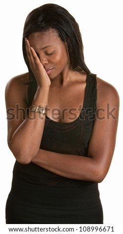 Shy young black woman with face in hand
