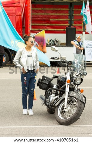 Shymkent, KAZAKHSTAN - April 23, 2016: Girl with a motorcycle at the opening of bike season in Shymkent, 23 April 2016
