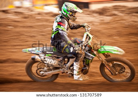 SI RACHA, THAILAND - MAR. 10 : A. Lupino (300) rider of CLS Monster Energy Kawasaki during MX2 race of The FIM Motocross World Championship Grandprix of Thailand, on March 10, 2013. Thailand. - stock photo