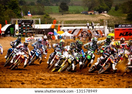 SI RACHA, THAILAND - MAR. 10 : Group of motocross riders at first curve during MX1 grandprix race 1 of The FIM Motocross World Championship Grandprix of Thailand, on March 10, 2013. Thailand. - stock photo