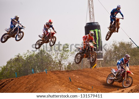 SI RACHA, THAILAND - MAR. 10 : Group of motocross riders jumping during MX1/2 last chance race of The FIM Motocross World Championship Grandprix of Thailand, on March 10, 2013. Thailand. - stock photo