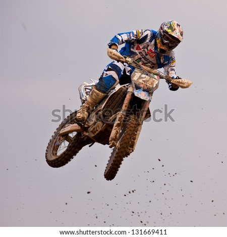SI RACHA, THAILAND - MAR. 10 : Ivo Monticelli rider no. 128 of TM Ricci Racing jumping during MX1 race of The FIM Motocross World Championship Grandprix of Thailand, on March 10, 2013. Thailand. - stock photo