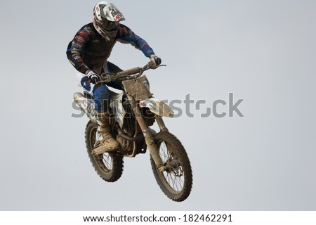 SI RACHA, THAILAND - MAR. 9 : Statue of Justs R. (195), Husqvama jumping in MX2 race during The FIM Motocross World Championship Grandprix of Thailand, on March 9, 2014. Si Racha, Chonburi, Thailand.