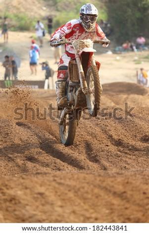 SI RACHA, THAILAND - MAR. 9 : Unidentify racer in MX2 race during The FIM Motocross World Championship Grandprix of Thailand, on March 9, 2014. Si Racha, Chonburi, Thailand. - stock photo