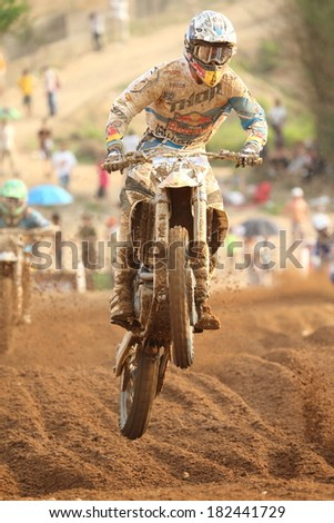 SI RACHA, THAILAND - MAR. 9 : Unidentify racer in MXGP race during The FIM Motocross World Championship Grandprix of Thailand, on March 9, 2014. Si Racha, Chonburi, Thailand. - stock photo