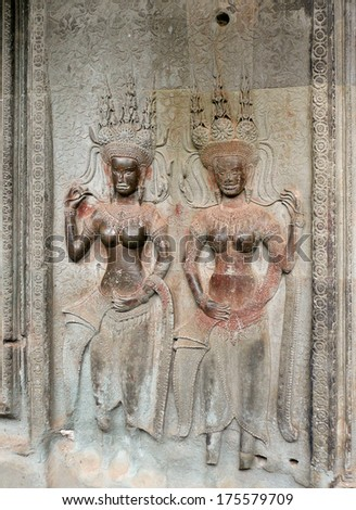 SIAM REAP, CAMBODIA: OCTOBER, 28, 2008, Bas-relief od dancing Goddesses on the wall of the Angkor Wat temples.