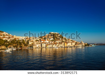 Sibenik is historic town in Croatia, located in central Dalmatia where river Krka flows into Adriatic Sea. Sibenik is political, educational, transport, industrial. - stock photo