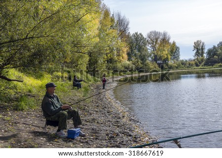 Siberia,Novosibirsk region,Kolyvan district,river Chaus,Russia - September 19, 2015: fishermen catch fish on the river Chaus autumn