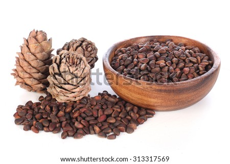Siberian cedar cones with nuts on a white background.