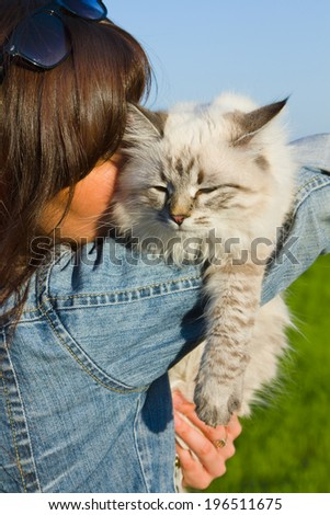 Siberian nevsky mask cat and young woman outdoors. - stock photo