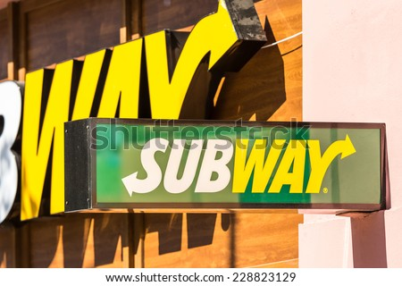 SIBIU, ROMANIA - AUGUST 19, 2014: Subway is an American fast food restaurant franchise that primarily sells submarine sandwiches and salads. - stock photo