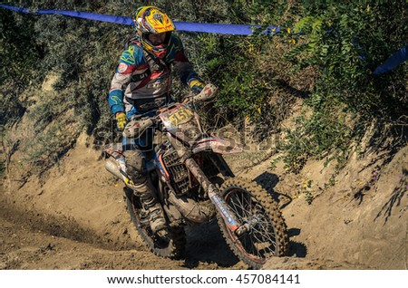 SIBIU, ROMANIA - JULY 16: A competitor in Red Bull ROMANIACS Hard Enduro Rally with a KTM motorcycle. The hardest enduro rally in the world. July 12-16, 2016