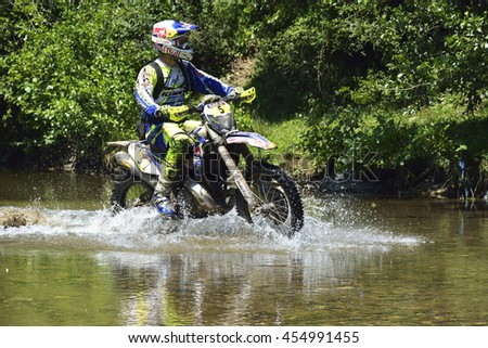 SIBIU, ROMANIA - JULY 12 - 16 JULY: Copetitors in Red Bull ROMANIACS Hard Enduro Rally with a KTM motorcycle. The hardest enduro rally in the world. July 12 - 16 July, 2016 in Sibiu, Romania.