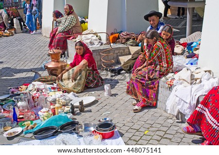 Sibiu, Romania - September 06, 2015: Gipsy selling they goods on the Small Square of Sibiu.