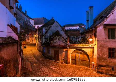 Sibiu, town in Transylvania, Romania. Old street of residential buildings - stock photo