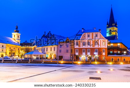 Sibiu, Transylvania. Evangelical Cathedral dominates Small Square with Huet Square, medieval Saxon city of Sibiu, Romania. - stock photo