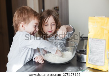 Siblings cooking holiday pie in the kitchen, casual still life photo series - stock photo