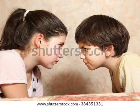 siblings couple brother and sister quarreling conflict - stock photo