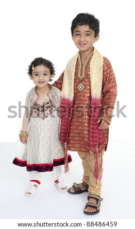 Siblings Display Traditional Indian Costumes - stock photo